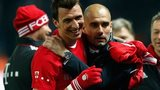 Pep Guardiola (right) celebrates winning the Bundesliga title