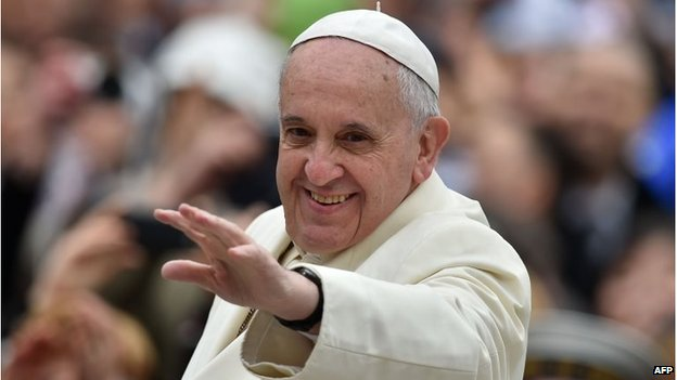 Pope Francis greets the crowd as he arrives for his general audience at St Peter's square on 26 March 26