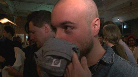 Man smelling t-shirt