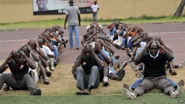Young Patriots exercise as they wait for the arrival of Charles Ble Goude in  Abidjan  (23 January 2011)