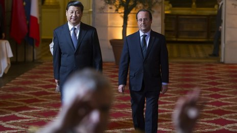 President Xi Jinping (left) held talks with his French counterpart Francois Hollande on Wednesday