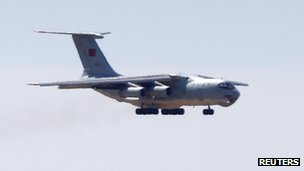 A Chinese Air Force Ilyushin Il-76 aircraft used in the search for Malaysia Airlines Flight MH370 prepares to land at Perth International Airport, 27 March 2014
