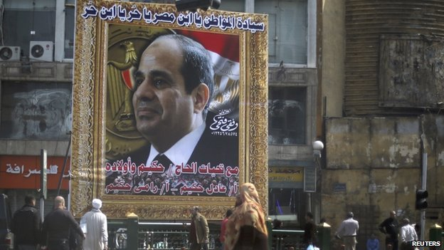 "Banner in Cairo promoting Field Marshal Sisi reads: ""Sovereign citizen. Sisi, son of Egypt. You are free. Son of freedom."""