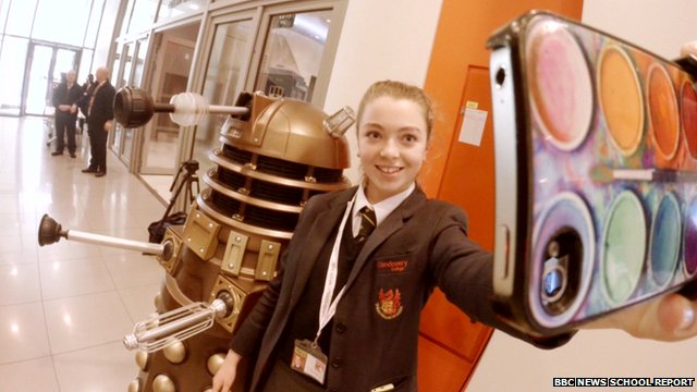 Schoool reporter taking a selfie with a Dalek