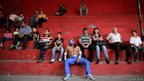Amateur wrestler Meteorito poses for a picture as he sits in the stands of the Arena Obreros in Saltillo, Mexico