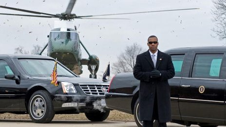 Secret service agent stands in front of a presidential vehicle in January 2010