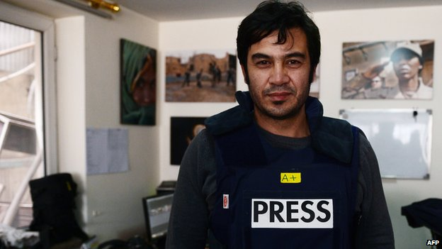 In this picture taken on March 20, 2014, Sardar Ahmad, 40, a Kabul based staff reporter at the Agence France-Presse (AFP) news agency poses for a photo at the AFP office in Kabul