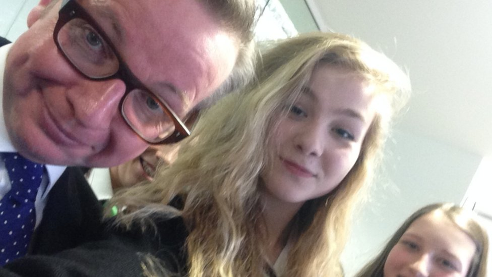 Michael Gove and two students do a selfie