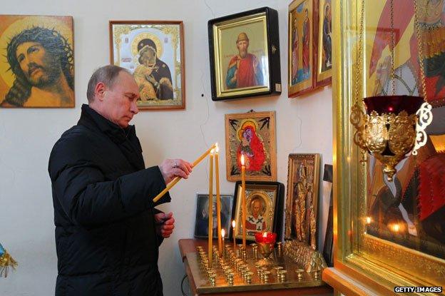 Putin in church 2013