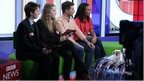 Newsround presenters Ricky Boleto and Leah Gooding with School Reporters from Lambeth Academy on The One Show sofa