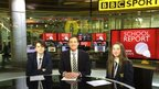 Henry and Niamh from Poynton High School sit with BBC Sport presenter, John Watson