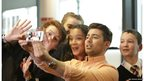 Presenters Ricky Boleto and Leah Gooding taking a selfie with students