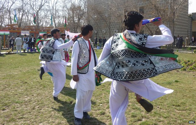 Afghan tribal dancers twirl, while wearing tribal waistcoats