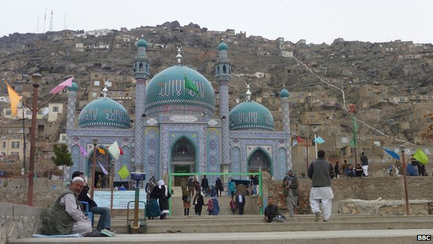 Western Kabul's blue-tiled Sakhi shrine, surrounded by steep hillsides