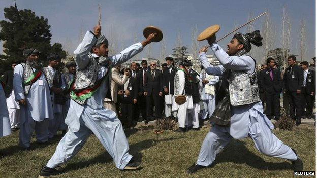 Afghan artists perform a traditional game during the international Nawroz celebrations