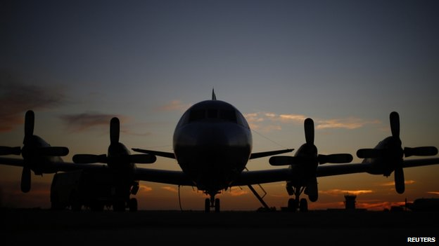 A Royal Australian Air Force AP-3C Orion aircraft is pictured in the sunset twilight after returning from a search flight for Malaysia Airlines flight MH370, at RAAF Base Pearce near Perth on 27 March 2014