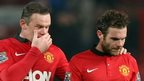 Wayne Rooney (left) consoles a dejected Juan Mata after Manchester United concede a third goal at home to Manchester City