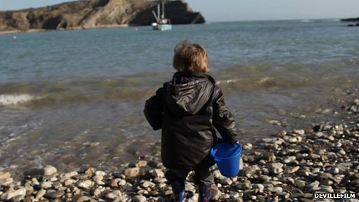 Boy at Lulworth Cove