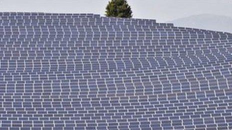 A solar farm in a field