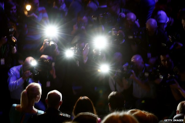 Celebrities in the glare of flashlight photography