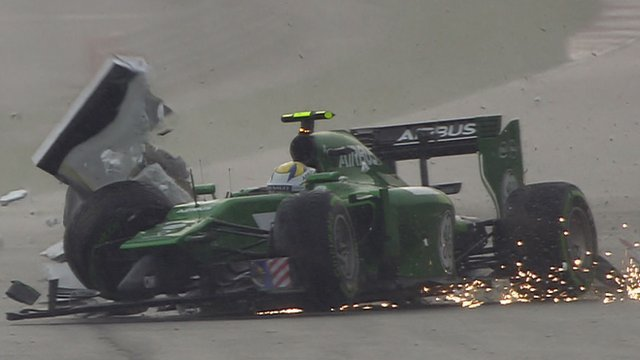 Caterham's Marcus Ericsson crashes in qualifying for the Malaysia Grand Prix