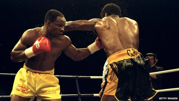 Chris Eubank (left) fighting in 1998
