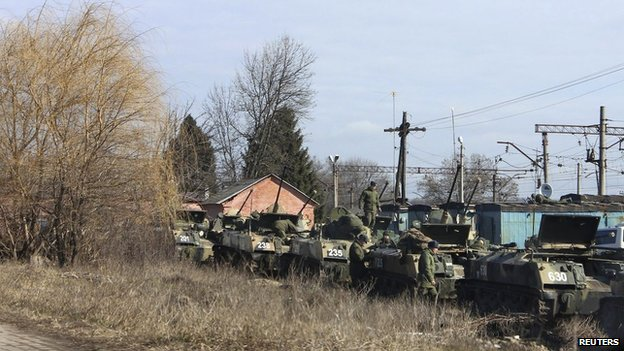 Russian light infantry fighting vehicles are seen on train carriages in the west Russian town of Vesyolaya Lopan about 12 miles (20 km) from the Ukrainian border, March 12, 2014