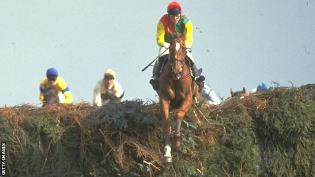 Mr Frisk, ridden by Marcus Armytage, jumps a fence on the way to victory in the 1990 Grand National