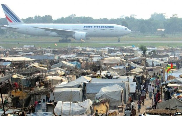 Plane land at Bangui airport, where some 100,000 people have sought protection