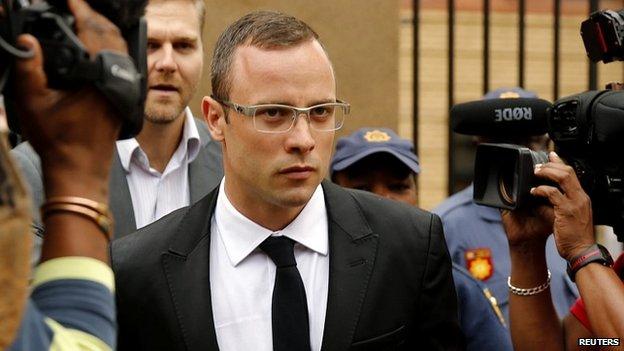 Oscar Pistorius leaves the courtroom in Pretoria - 28 March 2014