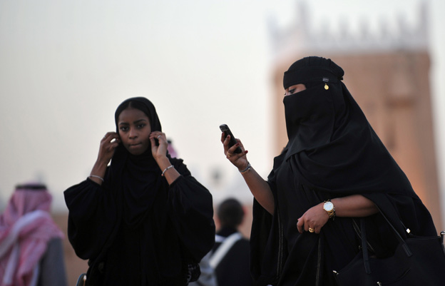 Saudi women arrive at the Janadriyah festival of Heritage and Culture held in the village of Al-Thamama, 50 kilometres north of the capital Riyadh, on February 22, 2014