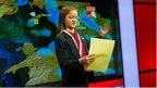 Olive from Malbank High School reading the local TV weather bulletin.
