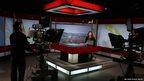 School Reporter in TV news studio