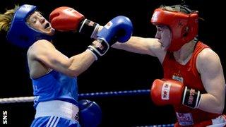 Katie Atkin lands a punch on Lynn Calder