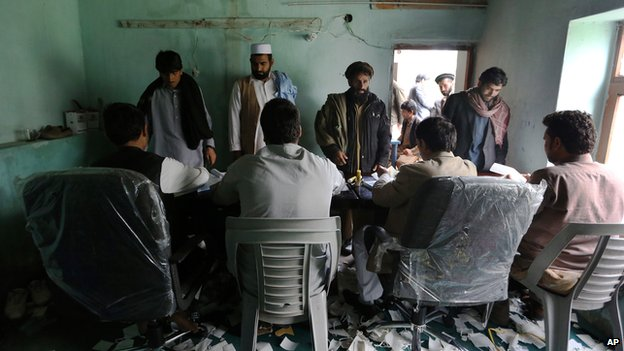 Employees of the Afghan Independent Election Commission register voters in Jalalabad east of Kabul, Afghanistan, on 29 March 2014.