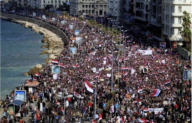Thousands of Egyptian anti-government protesters march in Alexandria on 11 February 2011