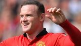 Manchester United striker Wayne Rooney celebrates after putting his side ahead from the penalty spot