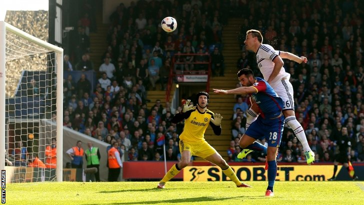 John Terry heads the ball into his own net