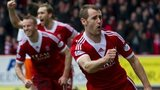Niall McGinn celebrates his equaliser