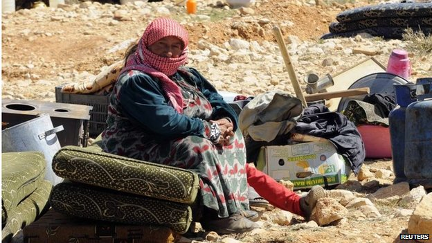 A Syrian refugee woman who fled fighting in the village of Flita