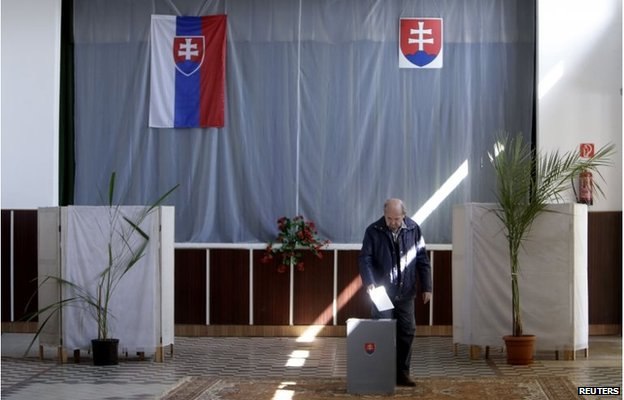A man casts his vote at a polling station during the presidential election runoff in the village of Velke Dvorany, north of Bratislava