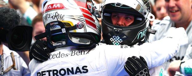 Lewis Hamilton embraces Nico Rosberg