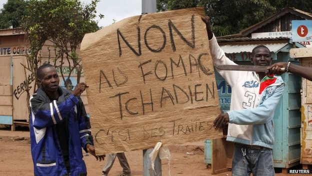 "Christian men hold a placard in Bangui reading ""No to Chad Multinational Force of Central Africa (FOMAC). They are traitors"" (file picture)"