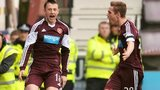 Hearts players Dale Carrick and Sam Nicholson celebrate