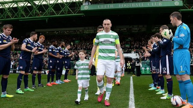 Scott Brown leads out Celtic as the Ross County applaud the newly-crowed Scottish Premiership champions