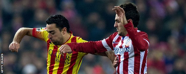 Koke and Xavi