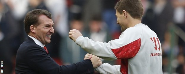 Liverpool manager Brendan Rodgers celebrates with Steven Gerrard