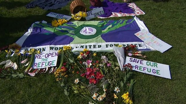 Protest flags and flowers