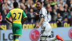 Jonathan de Guzman puts Swansea ahead in their Premier League match against Norwich at the Liberty Stadium