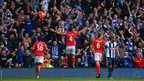 Steven Caulker celebrates in front of the Cardiff fans after scoring an equaliser at West Brom to make it 2-2